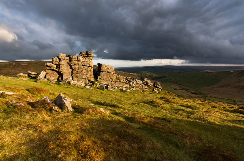 A short period of intense light as the storm clouds break at Hookney Tor, Dartmoor